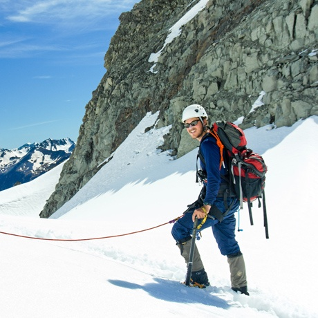A student mountaineering on a snowy peak in New Zealand.