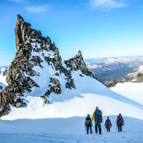 Students take in a sweeping view while mountaineering past craggy spires in Patagonia.