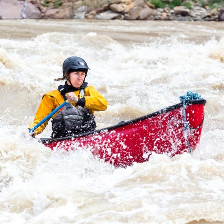 A course participant whitewater canoeing rapids on the Yampa River.