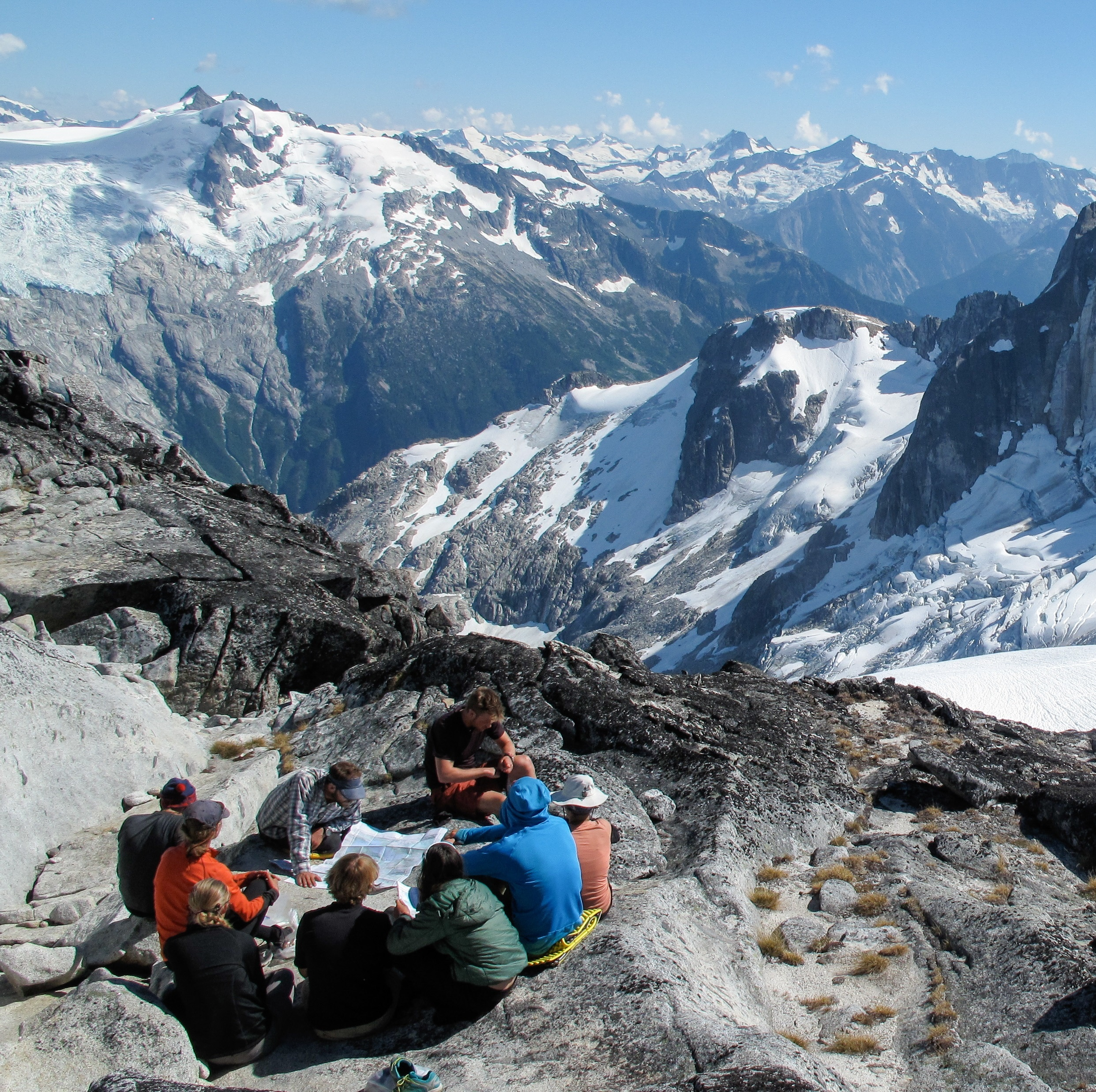 Students on the top of a mountain peak in the Pacific Northwest