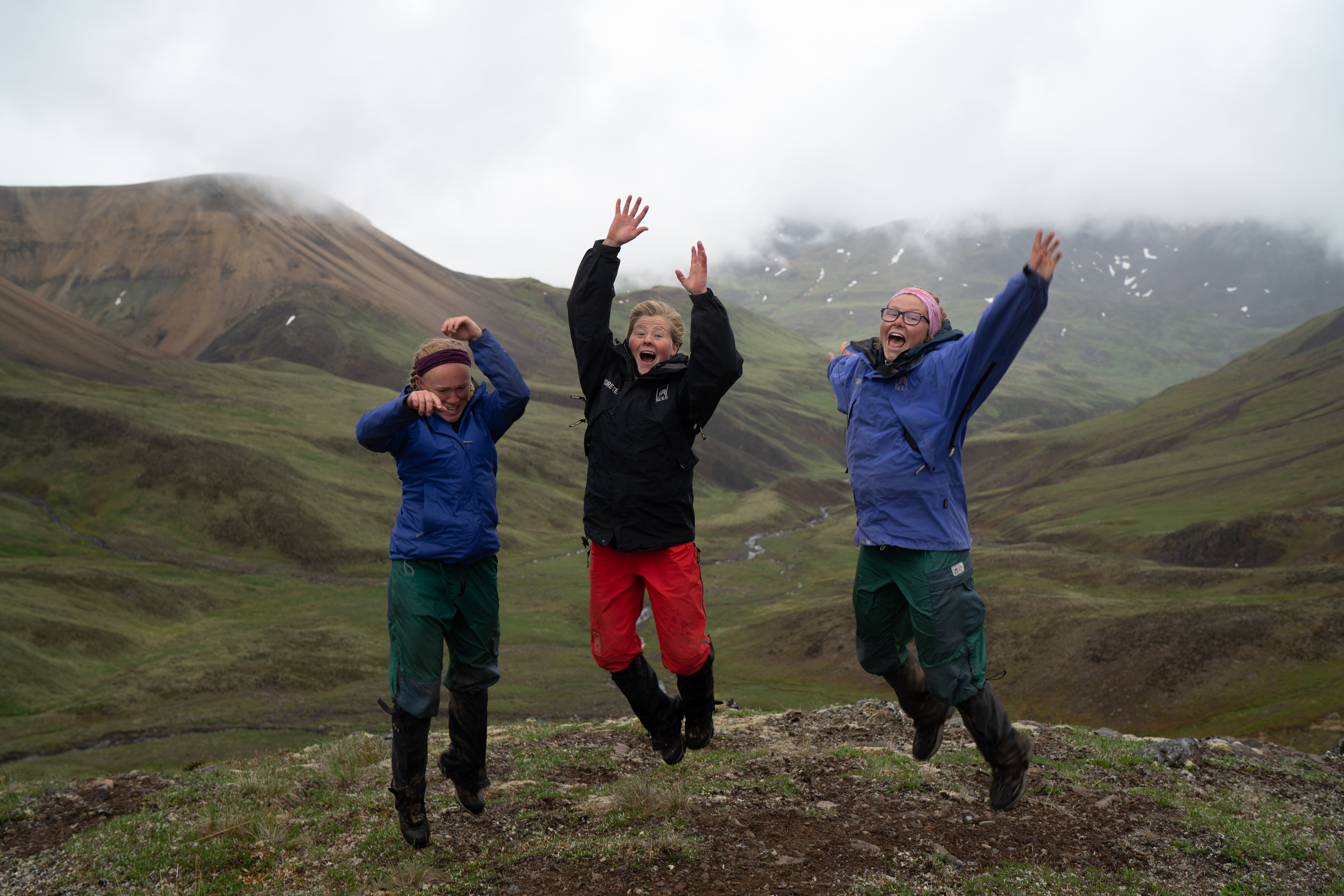 Students jump in the Alaskan mountains.